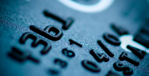 teal credit card digits close-up