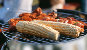 Corncobs and meat on grill